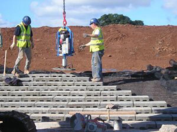 dam spillway concrete blocks - installing